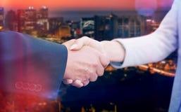 Composite image of corporate people doing handshake Stock Photo