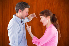 Composite image of couple arguing with each other Royalty Free Stock Photography
