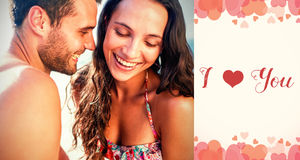 Composite image of couple on beach and valentines words. Composite image of couple on beach against backgrounds working Royalty Free Stock Image
