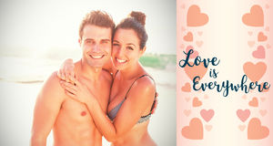 Composite image of couple on beach and valentines words. Composite image of couple on beach against backgrounds working Royalty Free Stock Photos