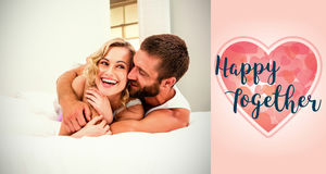 Composite image of couple on bed and valentines words. Composite image of couple on bed against backgrounds working Royalty Free Stock Images
