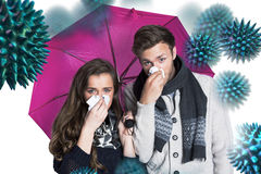 Composite image of couple blowing nose while holding umbrella. Couple blowing nose while holding umbrella against virus stock photo