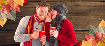 Composite image of couple both having warm drinks Royalty Free Stock Images