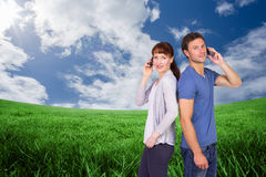 Composite image of couple both making phone calls Royalty Free Stock Photography