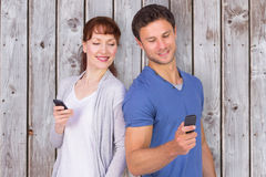 Composite image of couple both making phone calls Royalty Free Stock Photo