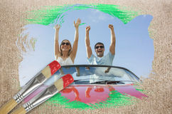 Composite image of couple cheering in convertible Royalty Free Stock Photos
