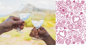 Composite image of couple clinking wine glasses outside Stock Photography