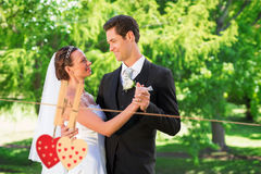 Composite image of couple dancing on wedding day Stock Image