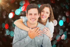 Composite image of couple embracing with arms around Royalty Free Stock Photography