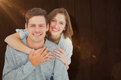 Composite image of couple embracing with arms around Royalty Free Stock Photo