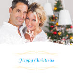 Composite image of couple embracing at christmas Stock Images