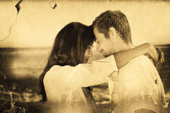 Composite image of couple embracing each other on the beach Royalty Free Stock Photo