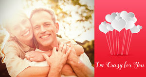 Composite image of couple embracing and valentines words. Valentines words against couple with arms around Royalty Free Stock Photos