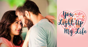 Composite image of couple embracing and valentines words. Composite image of couple embracing against backgrounds working Stock Photo