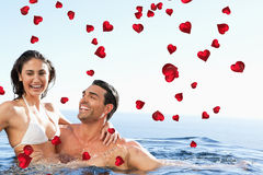 Composite image of couple enjoying time together in the pool Royalty Free Stock Images