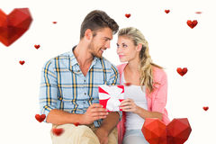 Composite image of couple with gift Royalty Free Stock Photo