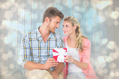 Composite image of couple with gift Royalty Free Stock Image