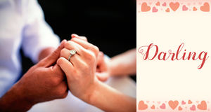 Composite image of couple hands and valentines words. Composite image of couple hands against backgrounds working Royalty Free Stock Photos