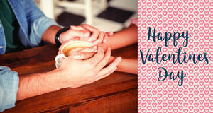 Composite image of couple hands and valentines words. Valentines words against cropped image of couple holding hands Stock Photography
