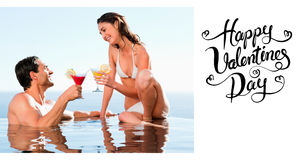 Composite image of couple having cocktails in the pool Royalty Free Stock Images