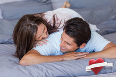 Composite image of couple having fun on the bed Stock Images