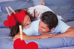 Composite image of couple having fun on the bed Stock Image