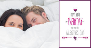 Composite image of couple hiding under the duvet Stock Photography