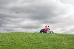 Composite image of couple holding a broken heart Stock Photos