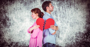 Composite image of couple holding a broken heart stock illustration