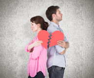 Composite image of couple holding a broken heart Royalty Free Stock Images