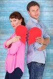 Composite image of couple holding a broken heart Royalty Free Stock Photos