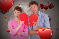 Composite image of couple holding a broken heart 3D. Couple holding a broken heart against love heart pattern 3D Stock Photo