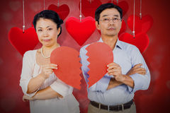 Composite image of couple holding broken heart 3d. Couple holding broken heart against valentines heart design 3d Royalty Free Stock Photography
