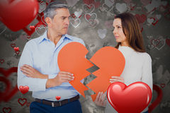 Composite image of couple holding broken heart shape paper 3D Stock Image
