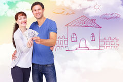 Composite image of couple holding fan of cash Royalty Free Stock Images