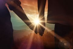 Composite image of couple holding hands in park Royalty Free Stock Photo