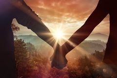 Composite image of couple holding hands rear view Stock Photography