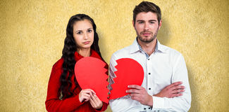 Composite image of couple holding heart halves Stock Photography
