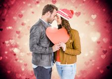 Composite image of couple holding a heart Stock Image