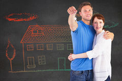 Composite image of couple holding keys to home Royalty Free Stock Images