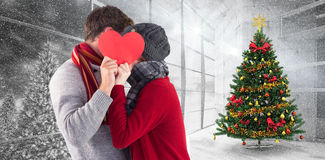 Composite image of couple holding a red heart Stock Photography
