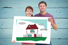 Composite image of couple holding a white sign Royalty Free Stock Photo