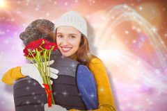 Composite image of couple hugging each other with red roses Royalty Free Stock Images