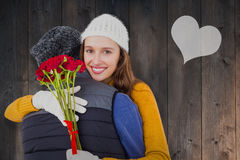Composite image of couple hugging each other with red roses Stock Images