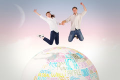 Composite image of couple jumping and holding hands royalty free stock photography