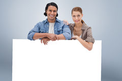 Composite image of couple leaning on blank wall Royalty Free Stock Photography