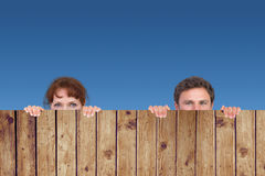 Composite image of couple looking at the camera stock illustration