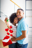 Composite image of couple and love letter 3d. Love letter against happy couple embracing in their new home 3d stock images