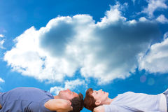 Composite image of couple lying on the floor Royalty Free Stock Image