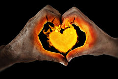 Composite image of couple making heart shape with hands Royalty Free Stock Photos